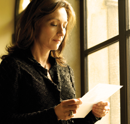 A woman reading letter by a window