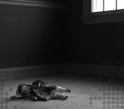 Photo of a doll lying on a floor